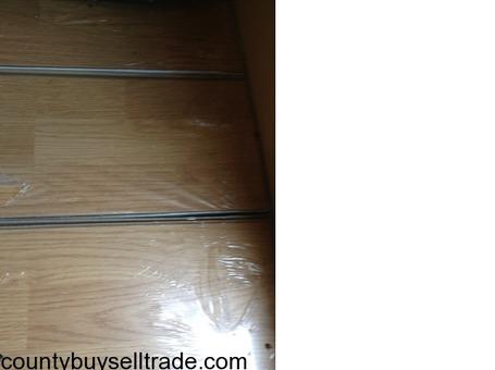 25 boxes laminate wood plank flooring